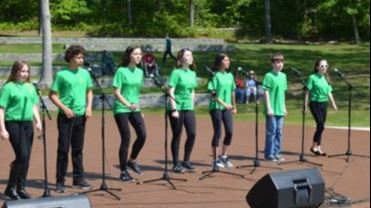 Singers at Good Ground Park opening day